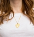 "Woman wearing Gold Tone Close To My Heart Medical ID Necklace. 1¼"" x 1½"" gold tone plated stainless pendant. Adjustable chain"