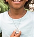 Boy wearing Color Me Fun Medical ID Necklace. Round color finish pendant, clear protective layer, engraving, on ball chain