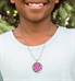 Boy wearing Color Me Fun Medical ID Necklace. Round color finish pendant, clear protective layer, pink caduceus, on ball chain