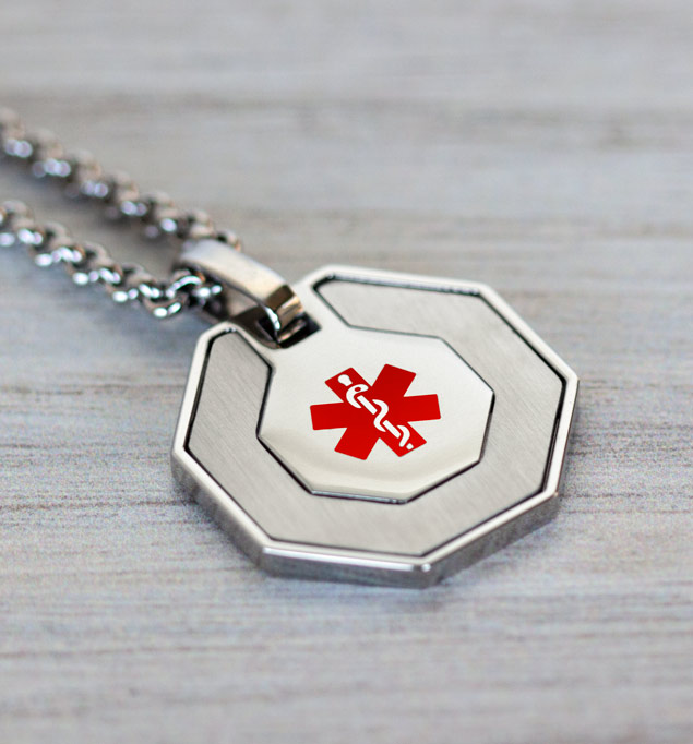 Stainless steel octagon medical ID necklace with red medical caduceus on the front on a stainless steel Rolo chain.