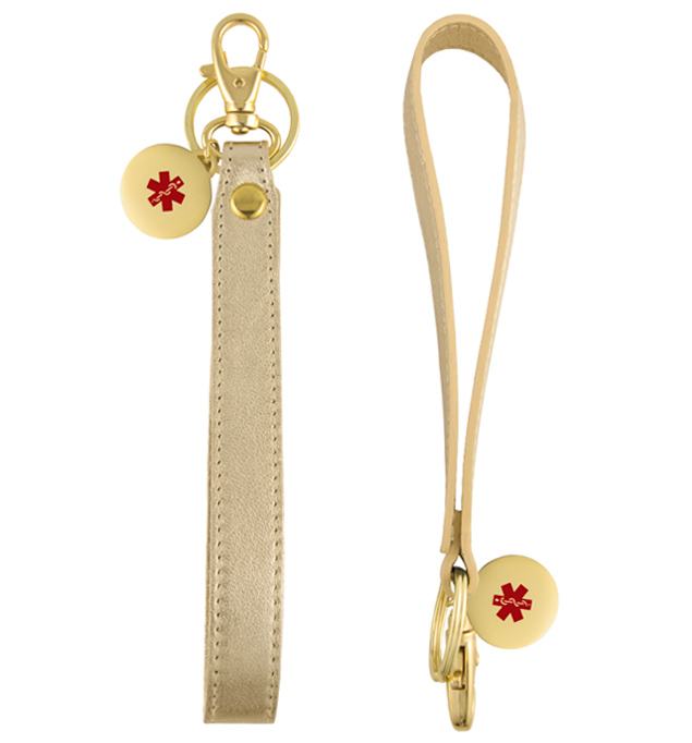 "Front and side view of  6"" long metallic gold tone leather Medical ID wristlet, and gold tone circle charm with red caduceus"