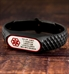 SportFit Tech ID Band in Black with custom laser engraving on wood table