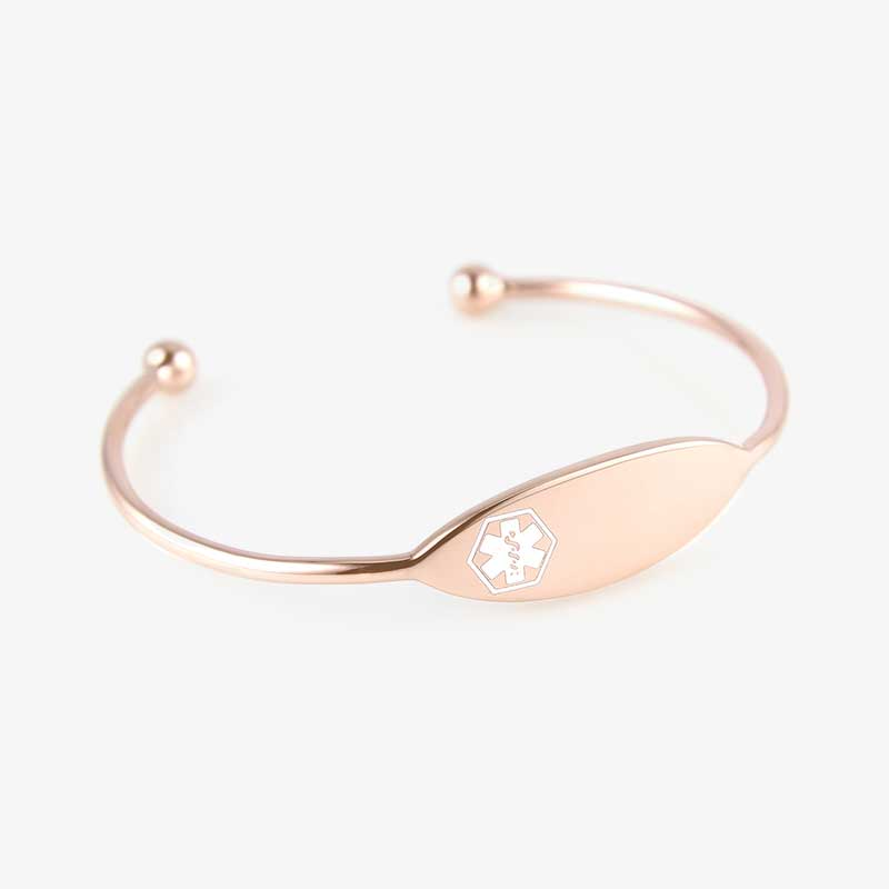Thin rose gold tone cuff with white medical symbol