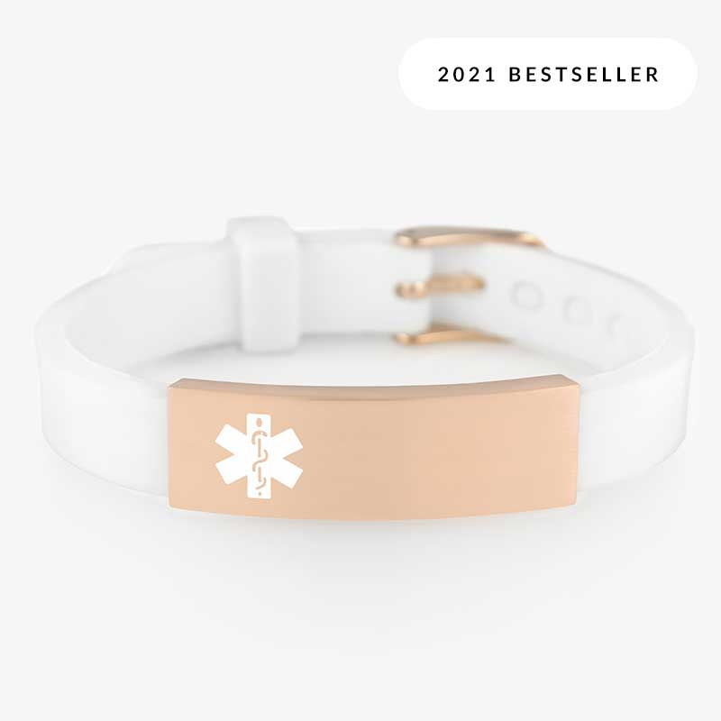 White silicone alert bracelet with watch style closure and rose gold medical alert tag