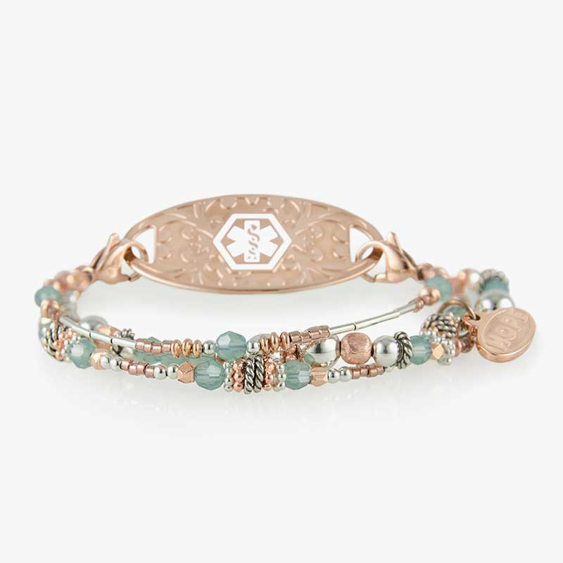 Mix and match bracelet with 3 strands of light blue and rose tone beads. Shown with a coordinating ID tag.