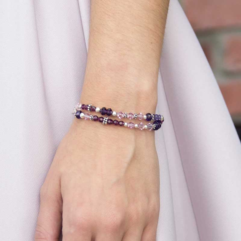 Crystals in various shades of purple with alternating Silver Balis beads bracelet shown on wrist