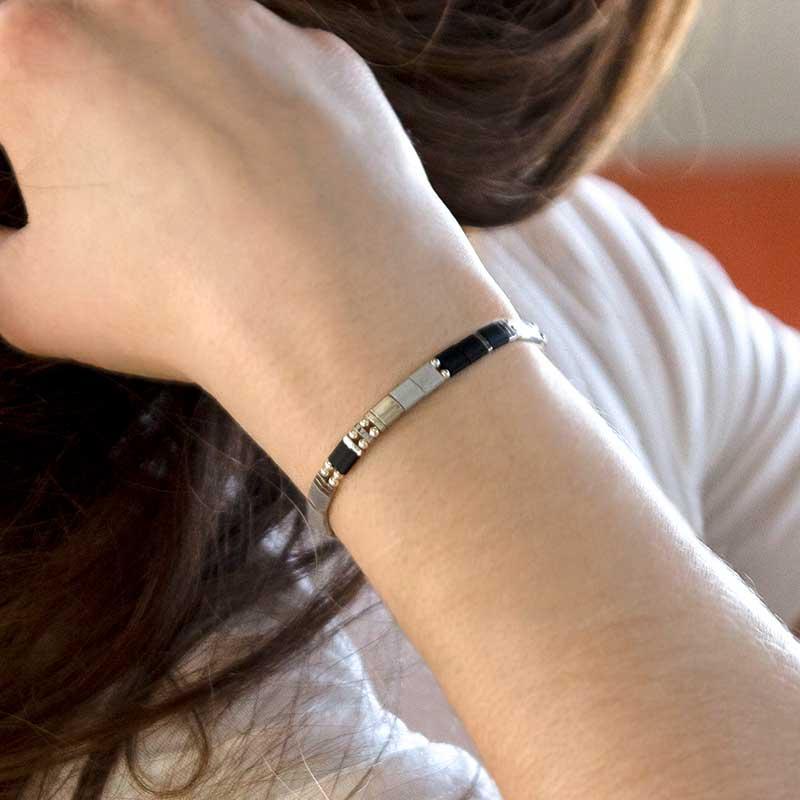 Woman wearing silver stretch medical ID bracelet