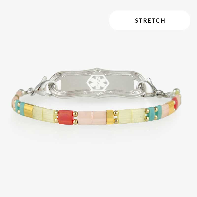 Brynn Stretch Bracelet with multi colored square beads and a silver medical ID tag with a white medical symbol