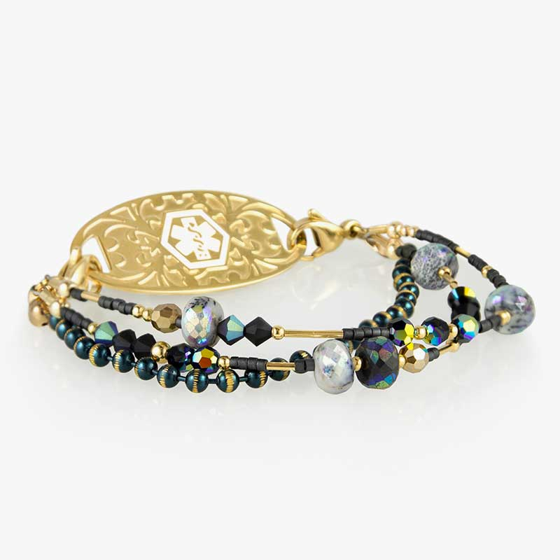 Beaded medical alert bracelet with gold tone accents with blue and black beads