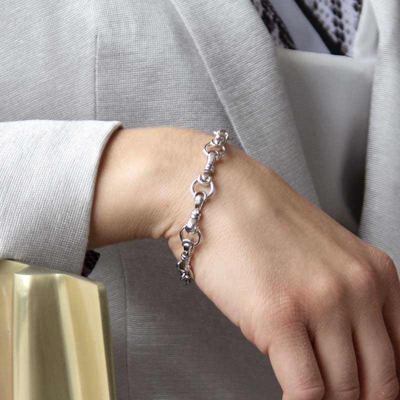 Woman wearing sterling silver bridle chain medical ID bracelet