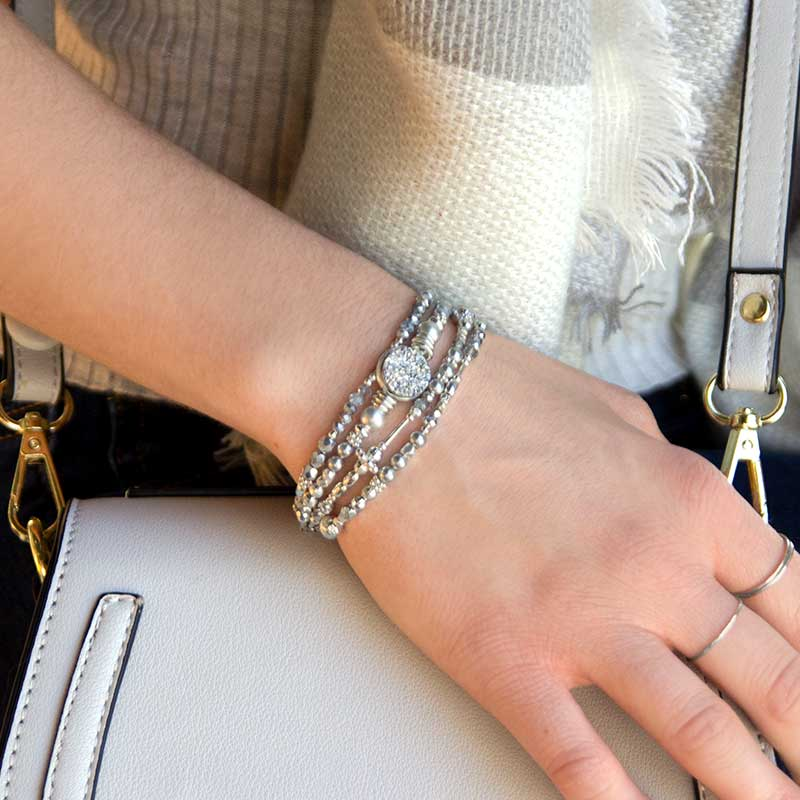 Woman wearing silver beaded medical alert bracelet with faceted druzy centerpiece