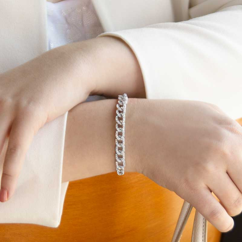 Woman wearing sterling silver curb chain medical alert with cubic zirconia