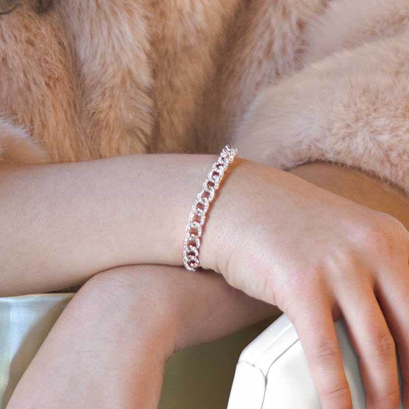 Woman wearing rose gold dipped sterling silver curb chain medical alert bracelet