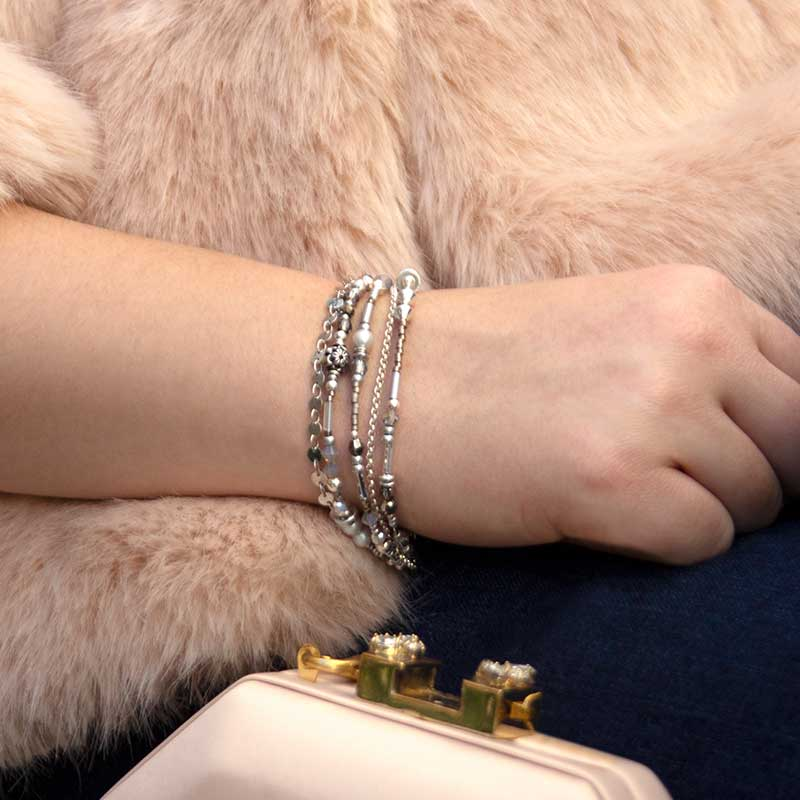 Woman wearing beaded medical alert bracelet with sterling silver beads and accents